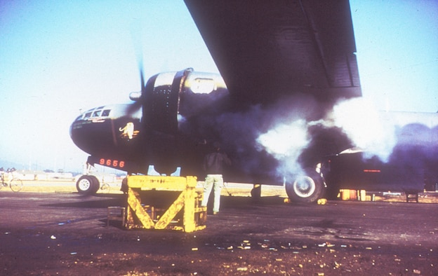 Belching smoke, engine No. 1 roars into life in preparation for takeoff. (U.S. Air Force photo)