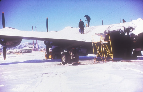 Sometimes mission preparation involved clearing the previous night's snow off the aircraft. (U.S. Air Force photo)