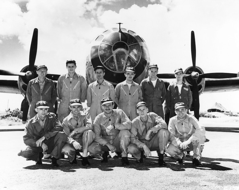 "Crew of ""Command Decision:"" (standing, left to right) Tech. Sgt. Carl W. Ayers, flight engineer; Sgt. Stanley Smigel, radio operator; **Staff Sgt. Michael R. Martoochia, central fire control; Sgt. John J. Nally, left gunner; *PFC Henry E. Ruch, right gunner; **Sgt. Merle A. Goff, tail gunner; (kneeling, left to right) Capt. Donald M. Covic, aircraft commander; Capt. David A. Self Jr., pilot; Lt. Daniel M. Price, navigator; 1st Lt. William M. Hammond, bombardier; 1st Lt. Bernard G. Stein, radar observer. (*Denotes number of MiGs shot down) (U.S. Air Force photo)"