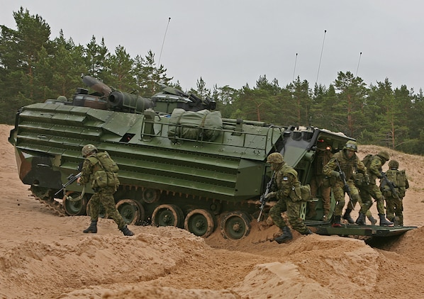 Estonian soldiers emerge from a U.S. Marine Corps amphibious assault vehicle during a combined U.S., Estonian amphibious landing at a beach here. The combined training demonstration was part Baltic Operations 2010, an exercise designed to increase the interoperability of NATO and partner nations in the Baltic Sea region.