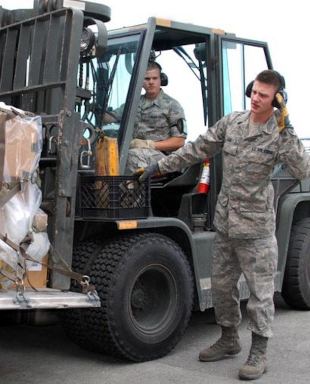 SrA David Williams drives the forklift while A1C Joseph Lenz guides him during the cargo build-up portion of the 176 LRS/ Aerial Port rodeo held Jun 12.