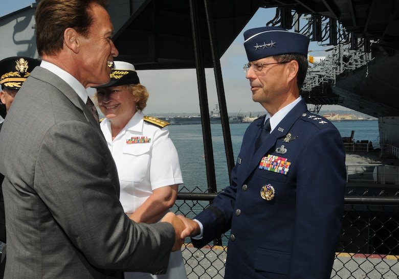 """Lt. Gen. John """"Tom"""" Sheridan, Space and Missile Systems Center commander, shakes hands with California Governor Arnold Schwarzenegger at the Operation Welcome Home kick-off, aboard the U.S.S. Midway in San Diego, June 3.   The first of its kind  in the nation, Operation Welcome Home is a statewide campaign to connect with returning veterans to determine their needs and connect them with the services that can help them transition successfully from the battle front to the home front.   (Photo by Joe Juarez)"""