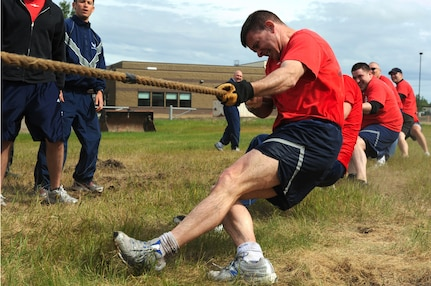 Members of the 517th Airlift Squadron pull the tug-o-war rope during the Arctic Warrior Olympics, June 11. The Arctic Warrior Olympics are held every June to bring the community on Joint Base Elmendorf-Richardson together. (Air Force photo by Senior Airman Cynthia Spalding)