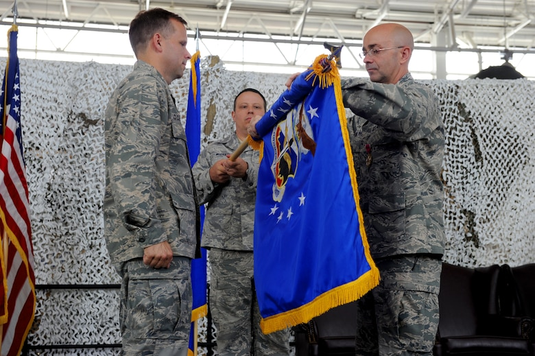 Col. James Hamilton cases his squadron's colors during its inactivation ceremony June 11, 2010, at Joint Base McGuire-Dix-Lakehurst, N.J. The inactivation will boost the capabilities of the wing's two remaining contingency response groups and assist with the creation of an Air National Guard CRG. Colonel Hamilton is the 816th Contingency Response Group commander. (U.S. Air Force photo/Tech. Sgt. Laura Deckman)