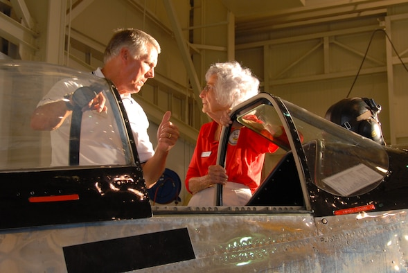 """Eagle Violet Cowden talks with the owner of the World War II vintage P-51, """"Ain't Misbehavin'"""" during the GOE barbecue. Of the 19 aircraft types Ms. Cowden flew during WW II as a WASP, she said the P-51 Mustang was her favorite.(U.S. Air Force photo/Jamie Pitcher)"""