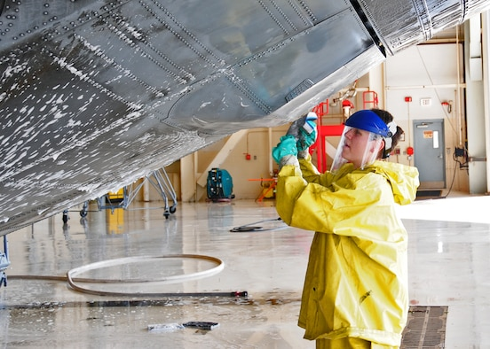 Members of the 914th Airlift Wing wash down a C-130 in hanger 901, May 27, 2010, Niagara Falls Air Reserve Station, Niagara Falls, NY. Aircraft become dirty from exhaust and from the particulates in the air and are routinely washed down as part of maintenance. (U.S. Air Force by Staff Sgt. Joseph McKee)