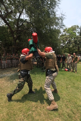 Cpl Christopher A. Franciose , a U.S. Marine with 4th platoon, Company C, 3d Assault Amphibian Battalion, 1st Marine Division, engages a Mexican Marine during a pugil stick exercise in Colima, Mexico, June 16.
