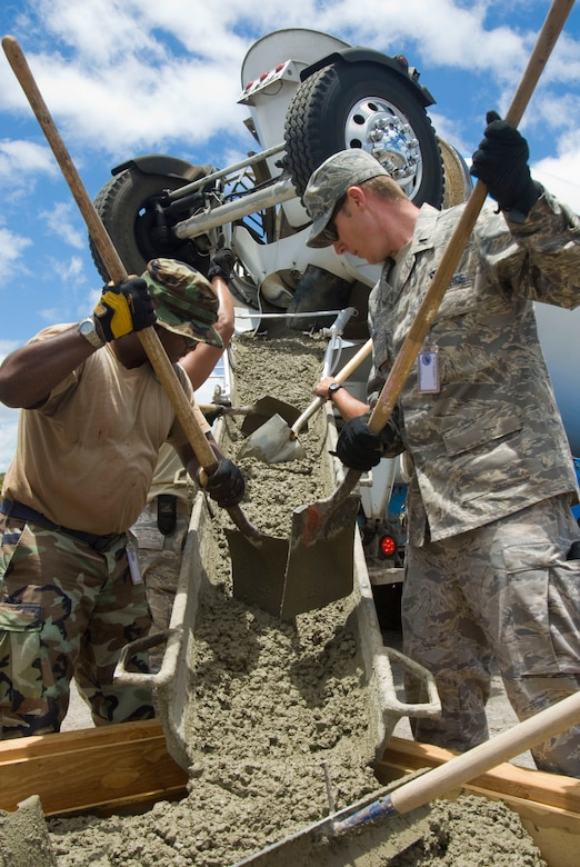 1st Lt. Ryan Barry assists Staff Sgt. Brent Parker from the 146th Civil Engineering Squadron with a concrete pour on Pearl City's Naval Base in Hawaii, June 14, 2010. The Civil Engineering Squadron is assisting with various construction projects at Pearl City Naval Base and U.S. Coast Guard Air Station, Barbers Point from June 4-18, 2010. (DoD photo by Airman 1st Class Nicholas Carzis, U.S. Air Force)
