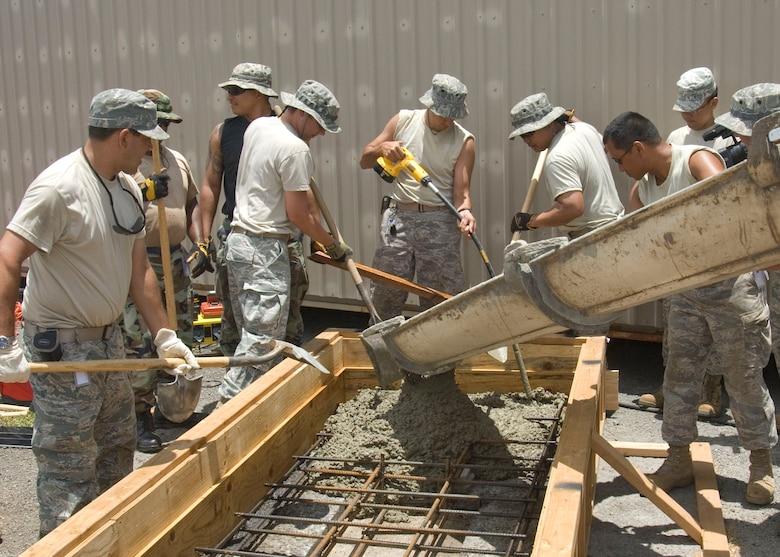 "Airmen from the 146th Civil Engineering Squadron known as the ""dirt boys"" assist with a concrete pour on Pearl City's Naval Base in Hawaii, June 14, 2010. The Civil Engineering Squadron is assisting with various construction projects at Pearl City Naval Base and U.S. Coast Guard Air Station, Barbers Point from June 4-18, 2010. (DoD photo by Airman 1st Class Nicholas Carzis, U.S. Air Force)"