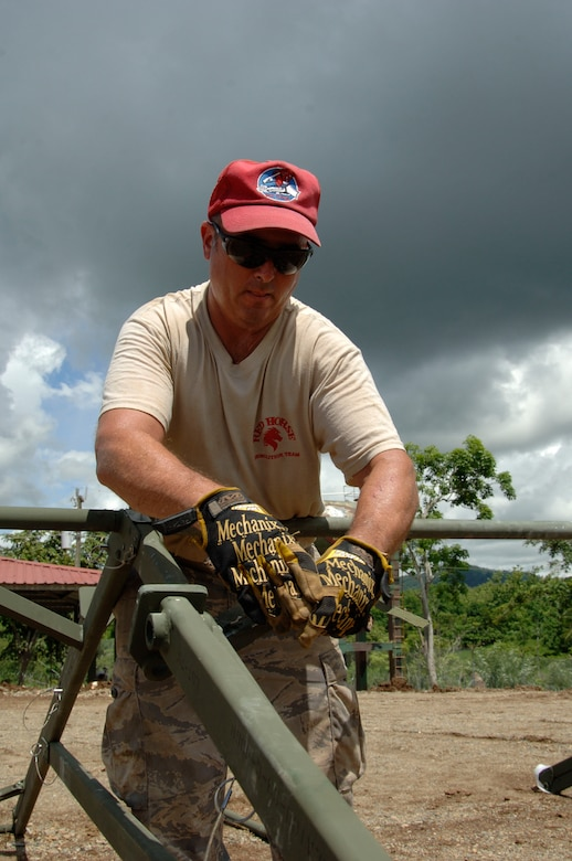 Tech. Sgt. Dave Chartier, 567th RED HORSE Squadron, puts together the roof of the dining tent at the temporary encampment that will house more than 250 Airmen, Soldiers, and Marines for New Horizons Panama 2010. (U.S. Air Force photo/Tech. Sgt. Eric Petosky)