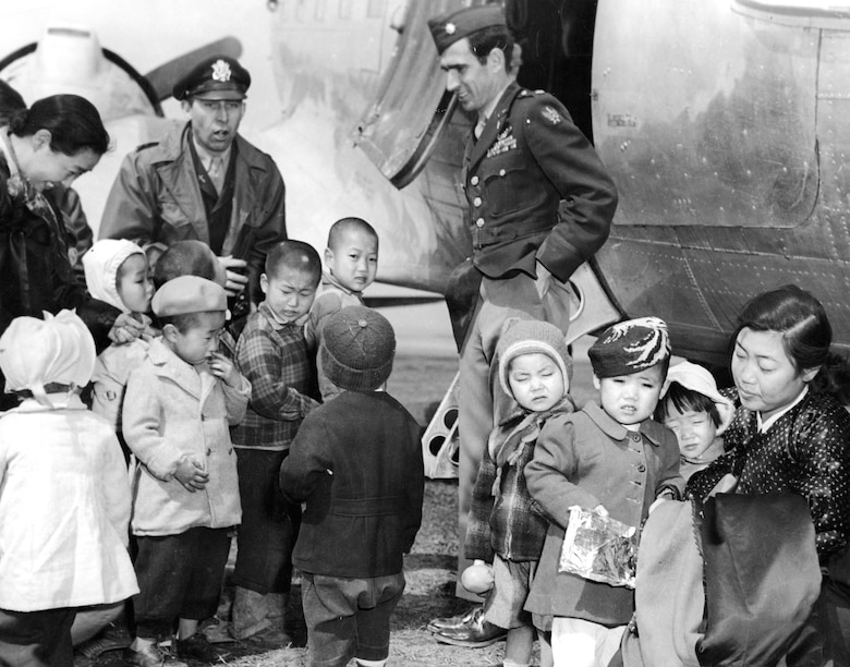 Chaplain Lt. Col. Russell Blaisdell (left) and Lt. Col. Dean Hess (right) on a return visit to Cheju-do. The children were now well-fed and clothed. (U.S. Air Force photo)