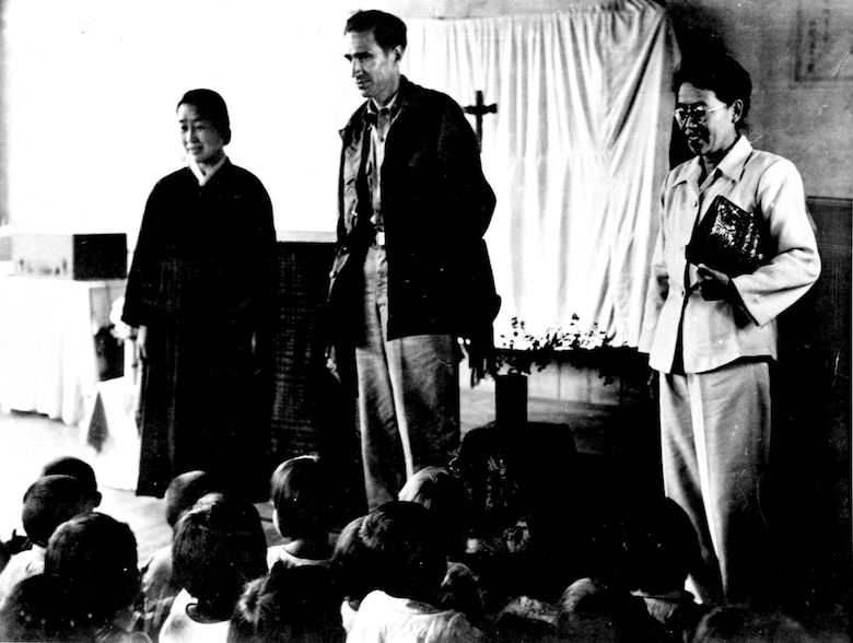 "Lt .Col. Dean Hess bids ""good-bye"" on his last visit to the Cheju-do orphanage before his transfer to the U.S. in May 1951. (U.S. Air Force photo)"