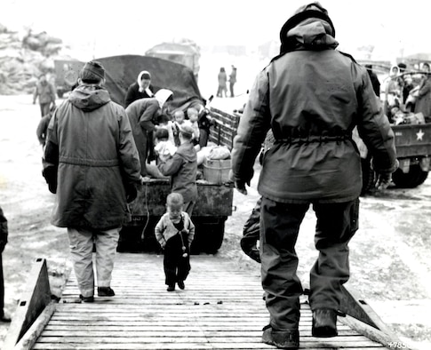 A Korean toddler climbs aboard a C-54 bound for Cheju-do. (