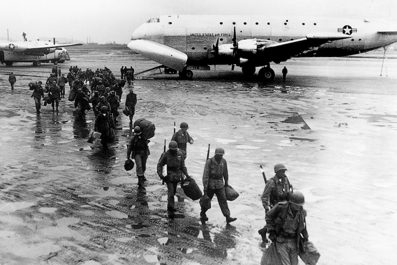 Soldiers return to Korea from a much needed five-day rest in Japan, transported aboard a USAF C-124. (U.S. Air Force photo)