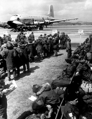 Because Japan was nearby and safe, troops could periodically enjoy 5-day rest and relaxation leaves there. These troops await USAF transport on a C-124 to Japan. (U.S. Air Force photo)