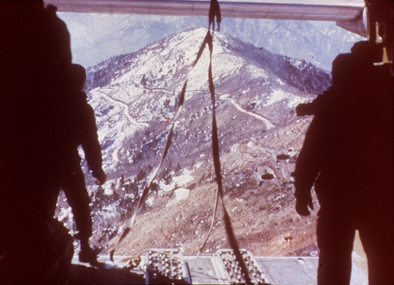 Rugged Korean terrain, seen from the back of a C-119 during a supply airdrop.  (U.S. Air Force photo)