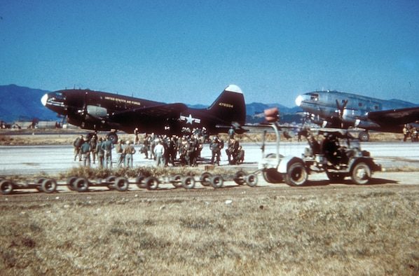 The World War II-era C-46 continued in service in Korea, where it airlanded supplies and supplemented C-119s during paratroop drops. (U.S. Air Force photo)