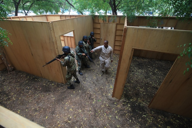 Mexican Marines stationed in Colima, Mexico enter a building during Military Operations in Urban Terrain (MOUT) training taught to them by U.S. Marines from 4th Platoon, Company C, 3d Assault Amphibian Battalion, 1st Marine Division, June 17.
