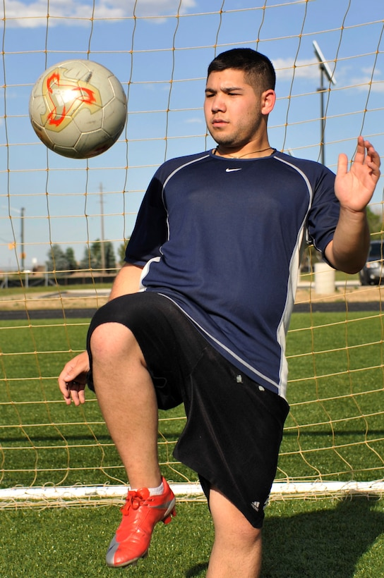 BUCKLEY AIR FORCE BASE, Colo. -- Airman 1st Class Nolan Luna-Chavez, 460th Space Communications Squadron, bounces a soccer ball on his knee to stay agile. No matter what the season's outcome, Airman Luna-Chavez says he still maintains good sportsmanship and respects his fellow athletes. (U.S. photo by Airman 1st Class Paul Labbe)
