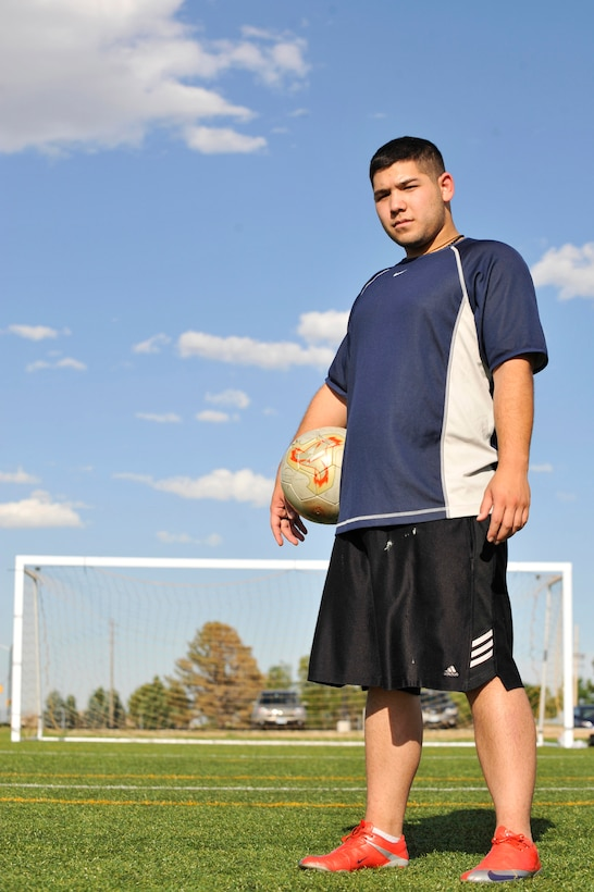 """BUCKLEY AIR FORCE BASE, Colo. -- """"I play soccer because it's fun and it gives me a good way to stay active,"""" says Airman 1st Class Nolan Luna-Chavez, 460th Space Communications Squadron. Airman Luna-Chavez plays a middle field position for the 460th SCS soccer team. (U.S. Air Force photo by Airman 1st Class Paul Labbe)"""