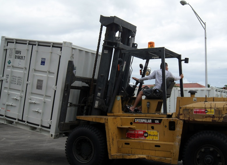 Airmen load the first shipment of materiel for New Horizons Panama 2010 onto trucks in Panama City. New Horizons Panama 2010 is a 12-week humanitarian assistance mission. More than 250 Airmen, Soldiers and Marines will deploy to six constructions sites and five medical missions in Panama. (U.S. Air Force photo/Staff Sgt. Teresa Burger)