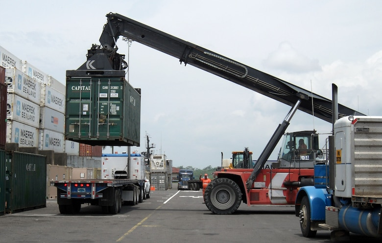 Airmen load cargo containers onto a flatbed truck at the the Panama City port in support of New Horizons Panama 2010, a 12-week humanitarian assistance mission. More than 250 Airmen, Soldiers and Marines will deploy to six constructions sites and five mecical missions in Panama. (U.S. Air Force photo/Staff Sgt. Teresa Burger)