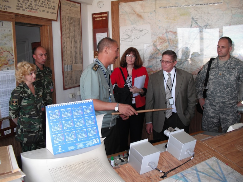 Members of an Electronic Systems Center-led Regional Airspace Study (RAS) team receive briefings in the Kyrgyz civil military coordination cell at Manas airfield in September 2009. The RAS identified deficiencies with, and proposed solutions for, civil and military air traffic control in Kyrgyzstan.  (Courtesy photo)