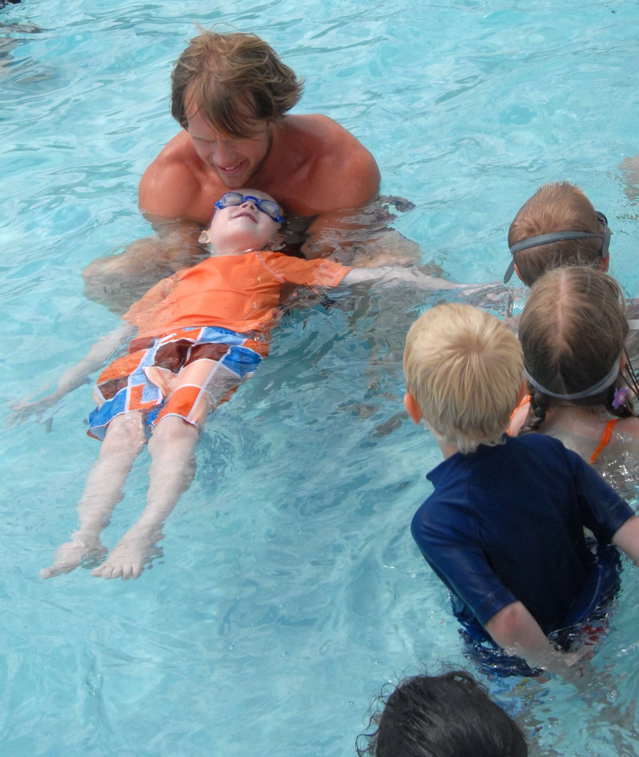 dason tucker a head lifeguard at china beach pool shows children how to float
