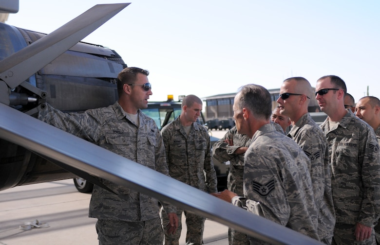 Tech. Sgt. Jeff Bentley, an instructor with the Tucson Aircraft Maintenance School, shows students around an F-16 Fighting Falcon on the Davis-Monthan Air Force Base flightline June 15. The first eight students to attend the school will graduate Aug. 17 as crew chiefs for their respective Air National Guard fighter units. The new school, operated by Arizona's 162nd Fighter Wing, will allow more Guardsmen to receive necessary training in a timely manner. (Air Force photo by Maj. Gabe Johnson)