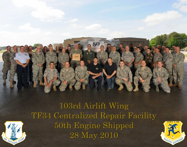 The 103rd Airlift Wing's TF-34 centralized repair facility commemorates shipping its 50th engine May 28, 2010, in the base hangar at Bradley Air National Guard Base, East Granby, Conn. In the photo are the CRF shop technician force, civilian contractors, support flight personnel and commanders. (U.S. Air Force photo by Tech. Sgt. Erin McNamara)