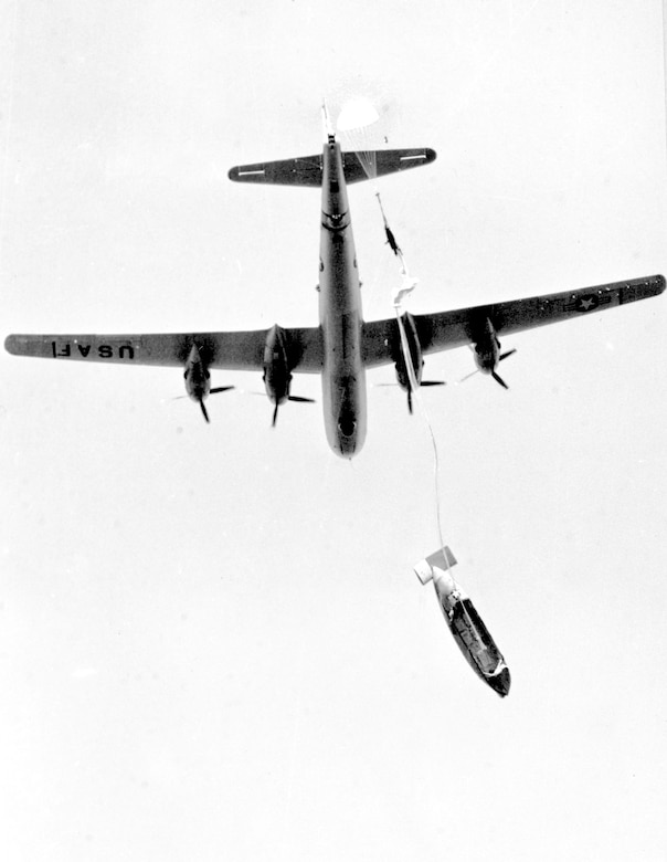 As the lifeboat falls away, a small drogue parachute opens the main parachute. (U.S. Air Force)