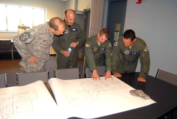BATTLE CREEK, Mich.—(Left to right) Seventeenth Air Force (Air Forces Africa) Command Chief Master Sergeant Mike Grimm and Vice Commander Brig. Gen. Mike Callan, view blueprints for new facilities with 110th Air Mobility Squadron Commander Lt. Col. Sean Southworth and 110th Air Operations Squadron Commander Col. Bryan Teff June 3.  The visitors spent time with the Michigan Air National Guard's 110 AOG, which has a supporting relationship to the AFAFRICA June 3-6. (U.S. Air Force Photo by Tech. Sgt. Alec Lloyd)