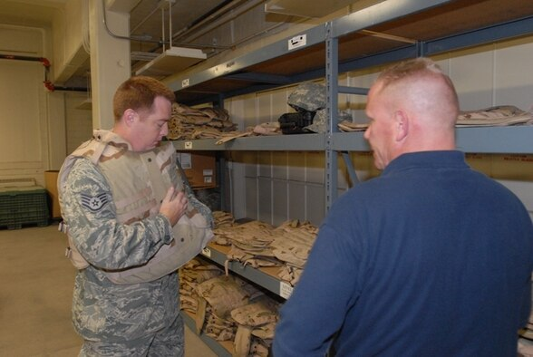 Staff Sgt. Chad Manson,  17th Contracting Squadron, tries on body armor at the Vance Deployment Center while David Swanson, 17th Logistics Readiness Squadron, stands by to assist him with getting the proper size June 15. (U.S. Air Force photo/Master Sgt. Randy Mallard)