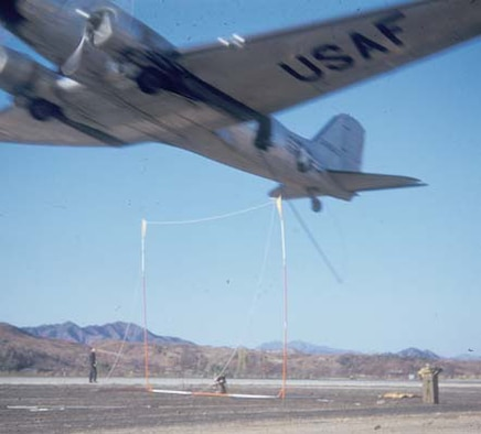 "Air Force special operation aircrews experimented with ""snatching"" personnel from the ground via a hook on a low-flying C-47. (U.S. Air Force photo)"