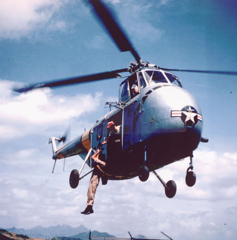 With the increasing use of helicopters, the USAF developed new rescue techniques including using hydraulic winches. Here, an Airman is hoisted aboard a hovering SH-19. (U.S. Air Force photo)