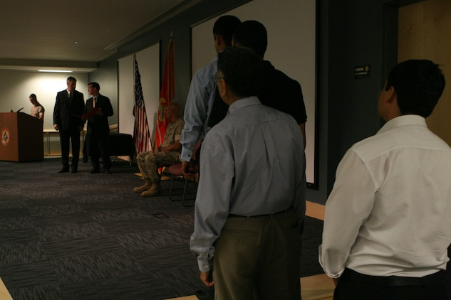 Language instructors with the U.S. Marine Corps Forces, Special Operations Command Advanced Linguist Course receive letters of appreciation at the MARSOC headquarters building, June 17. The instructors taught the MARSOC ALC 52-week long Dari, Pashtu and Urdu courses, which began on June 1, 2009.