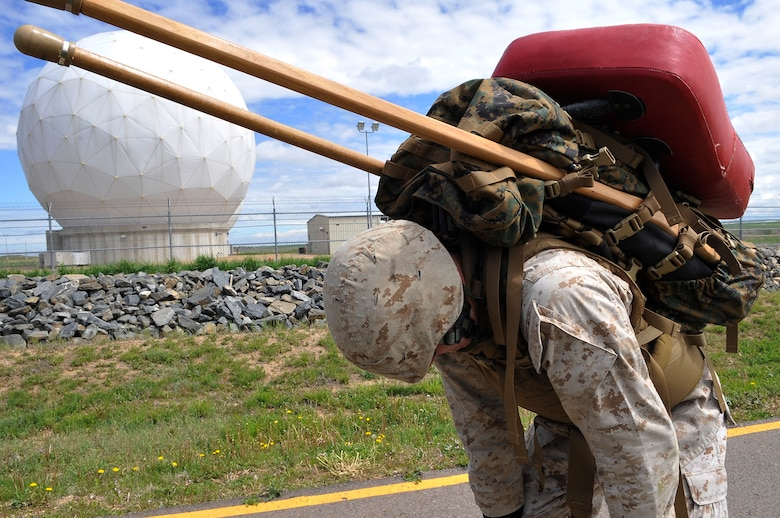 BUCKLEY AIR FORCE BASE, Colo. --Cpl Trent Wilcox, MACS 23 takes a quick rest. Most Marines who participate in advanced MCMAP training - especially the ones seeking their instructor tabs - are in excellent physical condition.(U.S. Air Force photo by Airman 1st Class Paul Labbe)