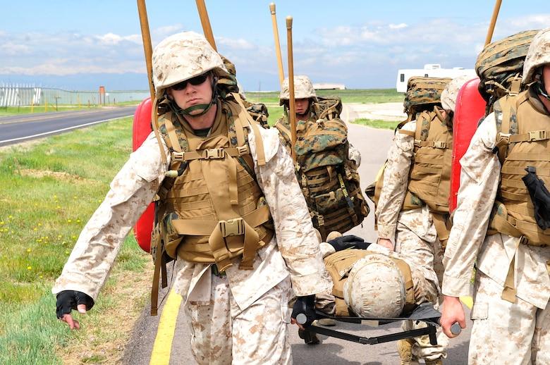 BUCKLEY AIR FORCE BASE, Colo. -- Macs 23 Marines Sgt Randall Blankenship, Cpl Trent Wilcox, Cpl Charles Bays, Sgt Dale S Steinecke carries SSgt Albert Martinez during a casualty exercise. The MCMAP class is open to all military members who wish to take part but there most be approval from there commander. (U.S Air Force photo by Airman 1st Class Paul Labbe)