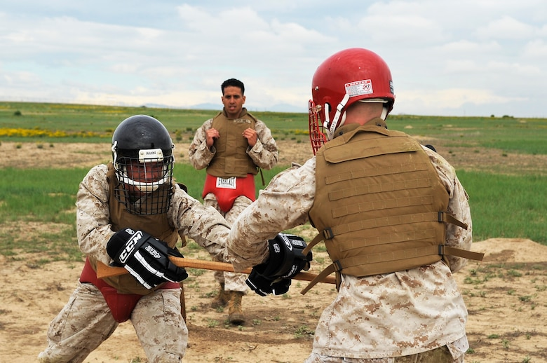 BUCKLEY AIR FORCE BASE, Colo. --SSgt Albert Martinez, Macs 23 observes  Sgt Randall Blankenship, Macs 23 and Cpl Trent Wilcox, Macs 23 engage each other in combat training. Students volunteer themselves to go through the 3 week Marine Corps martial Arts Program course.(U.S Air Force photo by Airman 1st Class Paul Labbe)