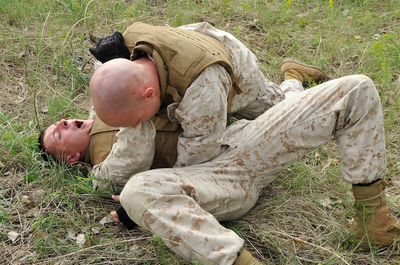 BUCKLEY AIR FORCE BASE, Colo. -- Macs 23 marines Cpl Charles Bays brawls with Cpl Trent Wilcox. Marine members take a three week Marine Corps Martial Arts Program course.(U.S Air Force photo by Airman 1st Class Paul Labbe)