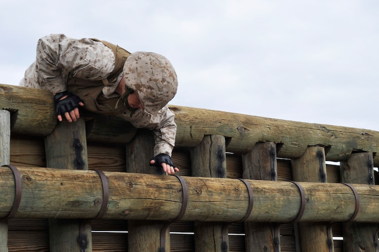 BUCKLEY AIR FORCE BASE, Colo. -- Sgt Randall  Blankenship,Macs-23 climbs over a wall while completing an obstacle course.Students volunteer themselves to go through the 3 week Marine Corps martial Arts Program course.(U.S Air Force photo by Airman 1st Class Paul Labbe)