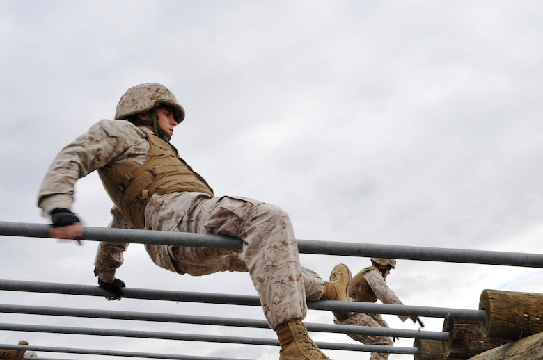 BUCKLEY AIR FORCE BASE, Colo. -- Sgt Randall  Blankenship,Macs-23 crosses   a bar obstacle. The course test students physically and also mentally.(U.S Air Force photo by Airman 1st Class Paul Labbe)