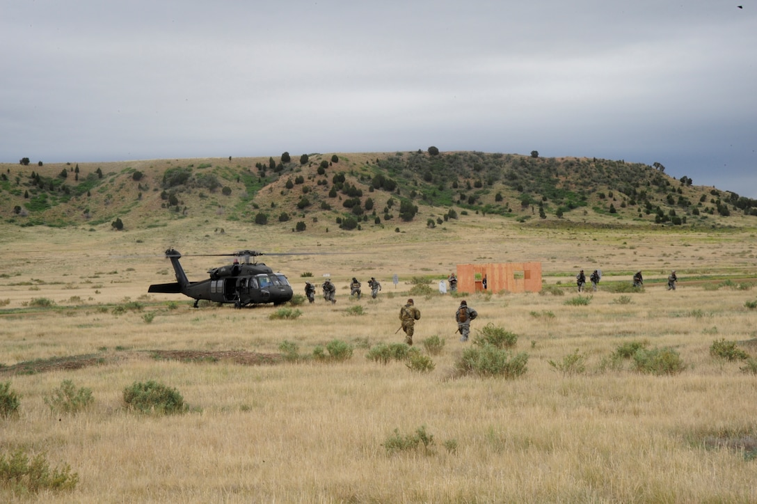 Members of the Air and Army National Guard joined forces at Fort Carson to conduct exercise in celebration of the 150th anniversary of the Colorado National Guard June 12.