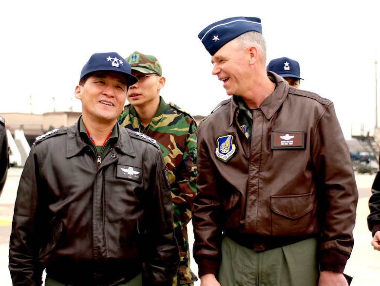 Airmen and partners: Korean Lt. Gen. Lee Han-Ho and USAF Brig. Gen. William Holland meet at Osan Air Base, Republic of Korea, 2003. (U.S. Air Force photo)