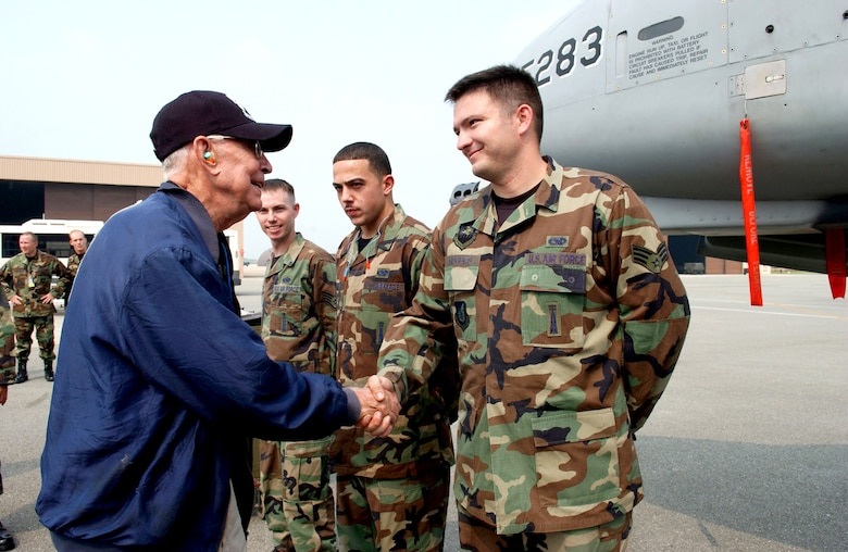 Generations connect: Air Force Korean War hero, POW and double ace Col. Harold Fischer greets 51st Fighter Wing personnel at Osan Air Base, Republic of Korea, in 2007. Fischer's story is highlighted in the Korean War Gallery at the National Museum of the U.S. Air Force. (U.S. Air Force photo)