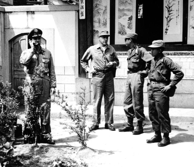 In Kaesong, Korea, USAF Col. Andrew Kinney radios results of preliminary armistice negotiations to headquarters. With him are (l-r) USMC Col. J.C. Murray, ROK Army Lt. Col. Lee Soo Young, and U.S. Army Chinese translator WOJG Kenneth Wu. (U.S. Air Force photo)