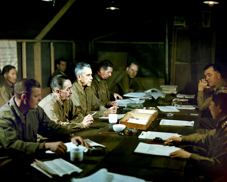 U.S. members of the UN delegation to the armistice conference attend a daily meeting at Panmunjom. Navy Vice Adm. C. Turner Joy, serving as chief delegate, is at the center left. (U.S. Air Force photo)