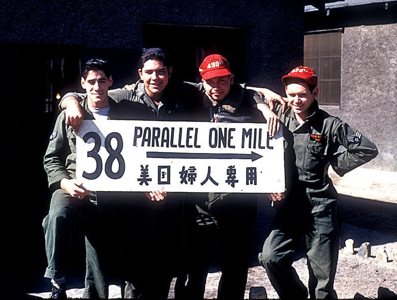 Airmen with a souvenir of the former north-south Korean border that was replaced by the Demilitarized Zone. (U.S. Air Force photo)