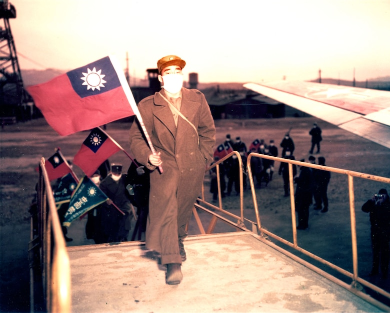 Recently released Chinese POWs carrying Taiwanese flags board a USAF transport in January 1954 for the flight to Taiwan and freedom after renouncing communism. Those communist POWs who returned to China and North Korea faced uncertain futures -- they were regarded as traitors for being captured. (U.S. Air Force photo)