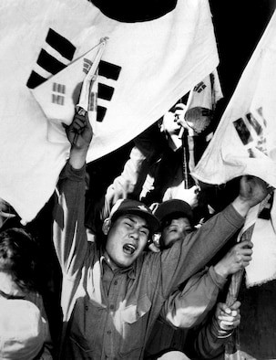 A former North Korean soldier shouts for joy upon reaching Seoul, South Korea, and freedom. Many North Korean and Chinese POWs renounced communism and chose to be released to new lives in South Korea and Taiwan. (U.S. Air Force photo)
